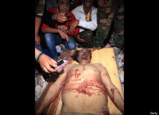 http://beritaekstrim.files.wordpress.com/2011/10/jenazah-khadafi-pucat.jpg?w=527&h=383